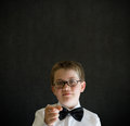 Your child or children need you boy dressed up as business man teacher student on blackboard background Stock Images
