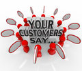 Your customers say satisfaction feedback happiness rating the words surrounded by people and speech bubbles to illustrate and Royalty Free Stock Image