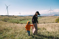 Your future mother and son in nature wind turbines in the background Royalty Free Stock Photography