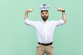 Your gift on my head. Funny young adult man holding gift box on head and pointing fingers on box. Royalty Free Stock Photo
