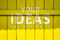 Your idea text on yellow Old Wood Background Royalty Free Stock Photo