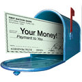 Your money check payment in mailbox a with the words arrives as Royalty Free Stock Photography