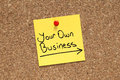 Your own business adhesive note pinned on cork bulletin board Royalty Free Stock Images