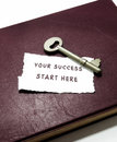 Your success start here with key on book Royalty Free Stock Photo