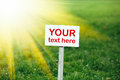 Your text here banner on green grass background Royalty Free Stock Photo