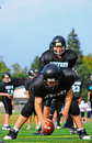 Youth American Football Center passes the ball Royalty Free Stock Photos