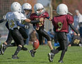Youth American Football loose ball Royalty Free Stock Photo