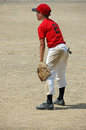 Youth baseball player in field Stock Image