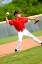 Youth baseball player throwing ball Royalty Free Stock Photos
