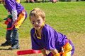 Youth flag football player hands knees Royalty Free Stock Photo
