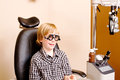 Youth at optometrist clinic with specialized glasses Royalty Free Stock Photography
