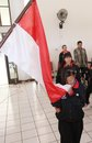 Youth paragames athlete disabled kiss indonesian flag before leaving for asen at malaysia in solo central java indonesia Stock Photos