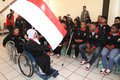 Youth paragames athlete disabled kiss indonesian flag before leaving for asen at malaysia in solo central java indonesia Royalty Free Stock Photography