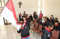 Youth paragames athlete disabled kiss indonesian flag before leaving for asen at malaysia in solo central java indonesia Stock Photography