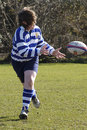 A youth rugby player passing a rugby ball !!