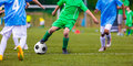 Youth soccer football teams kicking soccer ball on sports field Royalty Free Stock Photo