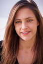 Youthful beautiful teenager with long brown hair and green eyes Stock Photo