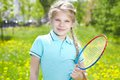 Youthful tennis player portrait of little girl with racket looking at camera Stock Images