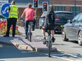 Youths doing stunts on bicycles on main roads in stratford upon avon Royalty Free Stock Photo