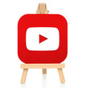 Youtube icon printed on paper and placed on wooden easel Royalty Free Stock Photo