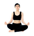 Youung woman meditating in lotus pose Stock Photo