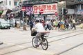 Yuen Long, Hong Kong- October 7, 2016: People crossing road and rail on foot and on bike at Yuen Long train station Royalty Free Stock Photo