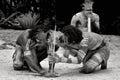 Yugambeh Aboriginal warriors men demonstrate fire making craft Royalty Free Stock Photo