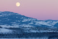 Yukon Canada winter landscape and full moon rising Royalty Free Stock Images
