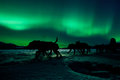 Yukon sled dog team pulling under northern lights Royalty Free Stock Photo