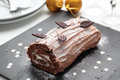 Yule log cake on a Christmas table Royalty Free Stock Photo