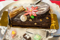 Yule log is a traditional dessert served near christmas it can be considered a type of sweet roulade Stock Image