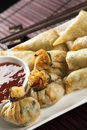 Yum cha fried wontons and spring rolls with chili sauce Royalty Free Stock Photography