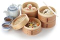 Yumcha dim sum in bamboo steamer chinese cuisine on a white background Stock Photo