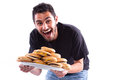 Yummmy a young happy man holding a plate full of cheesburger cheeseburger to be exact Stock Photography