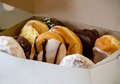 Yummy box of donuts a delicious are filled with delectable calories Stock Photo