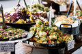 Yummy salads in restaurant displayed on buffet individual containers Royalty Free Stock Photos