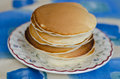 Yummy yummy homemade pancakes are laying on a vintage floral plate Royalty Free Stock Images