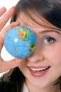 Yung beauty girl hold globe in front of eye Royalty Free Stock Photo