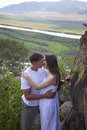 Yung couple hugging in mountains happy young with river on background Royalty Free Stock Images