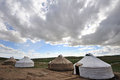 Yurts with clouds mongolians it is also known as zhanfang located in xinjiang china Stock Photo