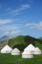 Yurts under blue sky mongolians it is also known as zhanfang located in xinjiang china Royalty Free Stock Photos