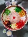 Yusheng - nice display of raw fish salads with 8 different Colours combinations