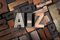 A z written with antique letterpress type vintage printing blocks on random letters background Stock Photography