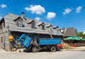 Zabljak montenegro august firewood delivery truck in front of the old wooden house is the city on the highest altitude of Stock Photo