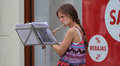Zagreb street musician young woman flutist playing flute on the of croatian capital Stock Photo