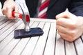 Zakenman smashing phone Royalty-vrije Stock Afbeeldingen