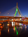 Zakim bridge at night leonard p bunker hill green led lights bathing the towers announcing a celtics boston basketball team game Royalty Free Stock Images