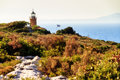 Zakynthos lighthouse beautiful landscape of greece with a and a greek flag Stock Image