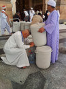 Zam water saudi arabia march people drink after praying at nabawi mosque compound Stock Image