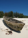 Zanzibar fishing boat an old on a beach in africa Stock Images